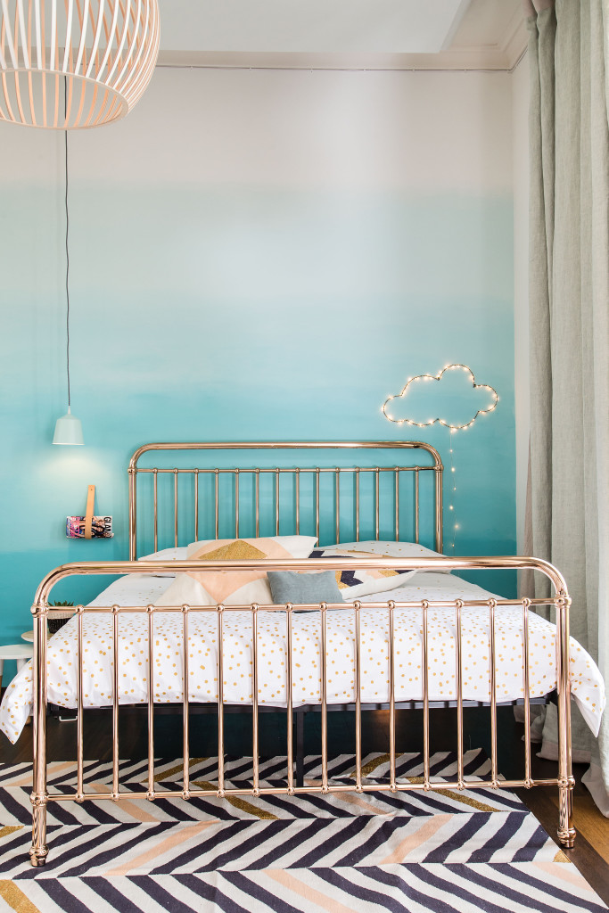 Incy interiors brass bed with Jotun dip dye wall